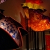 Colorful creations seem to glow in the dimly-lit galleries of the Oklahoma City Museum of Art where Dale Chihuly glass collections are on display.