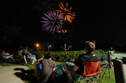 Spectators relax on blankets and in lawn chairs to take in the massive fireworks show at the University of Central Oklahoma in Edmond.  This show is the finale of LibertyFest, ranked one of the Top 10 Fourth of July celebrations in the nation.