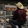A rodeo cowboy watches the action from the sidelines at the International Finals Youth Rodeo in Shawnee.