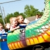 The Rooster Days Festival in Broken Arrow features many family-friendly activities including kid-sized rides.