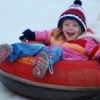 Snow tubing is one of the main attractions during the Downtown in December celebration in Oklahoma City.  A giant sledding slope is created inside the Chickasaw Bricktown Ballpark.  It's fun for the whole family and includes a smaller slope for the tots.