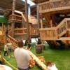 A two-story treehouse welcomes guests to the Gadget Trees exhibit at Science Museum Oklahoma.  Visitors can slide down one of the nation's tallest spiral slide and learn about simple machines, like a lever cleverly disguised as a teeter-totter.