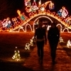 Yukon's Christmas in the Park celebration draws over 50,000 visitors annually to enjoy the 100-acre holiday light extravaganza featuring more than one million light bulbs.