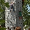 Kids test their climbing skills on the rock wall during Tulsa's International Mayfest event.  This event draws over 350,000 visitors annually and is a family-oriented tribute to music and the arts.