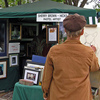 An artist works near her booth during the May Fair Arts Festival in Norman.