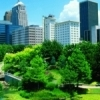 The Oklahoma City skyline rises above the lush grounds of the Myriad Botanical Gardens.