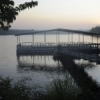 A fishing dock makes a picture-perfect setting to relax and drop a line on the Lake of the Arbuckles, adjacent to the Chickasaw National Recreation Area in Sulphur.