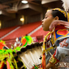 A jingle dress dancer in the performance arena at the Red Earth Native American Cultural Festival in Oklahoma City.  Over 100 tribes from across North America are represented each year at this festival and art show.