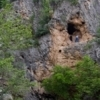 Adventurous hikers can explore a cave in the side of the cliff just above the cascade at Turner Falls.