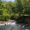 Visitors swim near one of the falls in Travertine Creek that runs through the Chickasaw National Recreation Area in Sulphur.  The area's mineral waters and lakes attract boaters, swimmers and fishermen, while its forests and prairies reward hikers and campers.