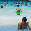 The wave pool at White Water Bay in Oklahoma City is a zero entry pool where even little ones can have a great time wading or bobbing in the waves.  The more daring can ride the big waves further out.