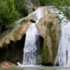 Swimmers enjoy the natural pool at the base of Turner Falls in Davis.  The 77-foot cascade is the centerpiece of the park where guests can swim, hike and camp.