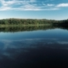 Lookout Lake reflects the clear blue sky at Osage Hills State Park in Pawhuska.  The 1,100-acre park features hiking trails and outstanding fishing, as well as historic cabins and picnic shelters built by the Civilian Conservation Corps in the 1920s.