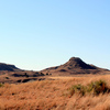The Antelope Hills are buttes and peaks located in a bend of the Canadian River in western Oklahoma near Durham.  They were mentioned as a campsite by Spanish explorer Coronado in 1541 and once marked the international border between the United States and Mexico.