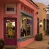 The Spanish architecture and clay tile roofs of the Paseo Arts District in Oklahoma City adds flair to this colorful and creative community.  More than 30 artists have established their studios and galleries in the district's stucco buildings.