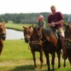 Horseback riding is a fun family activity at central Oklahoma's Tatanka Ranch in Stroud.  Guests can enjoy cabin stays, horseback riding, paddle boating, kayaking, swimming and more at this Oklahoma guest ranch.