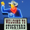 A neon sign welcomes visitors to historic Stockyard City near downtown Oklahoma City.  The area is the largest stocker/feeder cattle market in the world and is home to more than 70 businesses specializing in fine Western wear, rustic furniture, farm and ranch needs and dining.