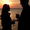 Share a toast and unwind with a glass of wine before enjoying a romantic dinner at sunset in the East Wharf area of Lake Hefner.