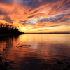 A dramatic sunset paints the skies above Lake Eufaula, the largest lake in Oklahoma and home of two state parks.
