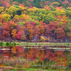 Brilliant fall colors set the hills surrounding Clayton Lake aglow.