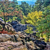 Colorful foliage contrasts with interesting rock formations throughout Robbers Cave State Park. Infamous outlaw, Belle Starr, once hid out in a cave among the rocky hills in the park, and now hikers enjoy the scenery while navigating the extensive trail system in the park.