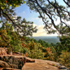 Rocky outcroppings along the hiking trails at Robbers Cave State Park offer magnificent vistas over the Sans Bois Mountains that surround the area.
