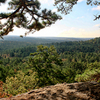 Pine trees frame a scenic vista over the Sans Bois Mountains along a trail at Robbers Cave State Park.