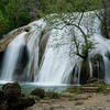 The 77-foot tall cascades at Turner Falls Park in Davis are a favorite outdoor spot.  A natural swimming pool is formed at the base of the picturesque falls where families can enjoy the cool waters and scramble around the rock formations.