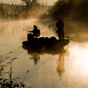 Fishermen cast a line in the early morning light at the Lake of the Arbuckles in Sulphur.