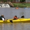 Paddlers enjoy rental kayaks on the Oklahoma River in downtown Oklahoma City.