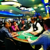Table games including poker and blackjack keep Riverwind Casino guests entertained 24 hours a day.