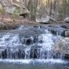 A peaceful waterfall flows at McGee Creek Natural Scenic Recreation Area near McGee Creek State Park in Atoka.