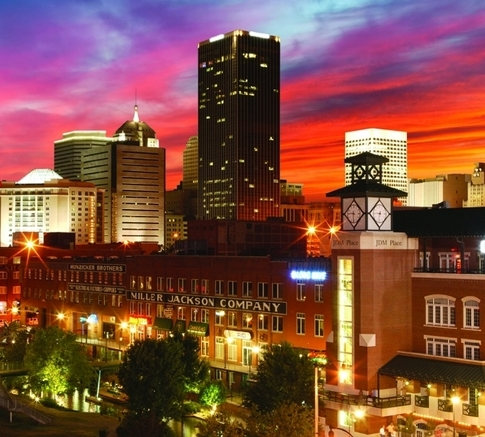 The view from the Bricktown Entertainment District is magnificent as the Oklahoma City skyline is drenched in the spectacular colors of an Oklahoma sunset.