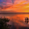 Overwhelming color paints the sky and waters of Lake Eufaula inspiring the senses as the sun sets.