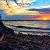 Roots, rocks and waves accentuate a beautiful sunset over Lake Eufaula, Oklahoma's largest lake and home to Eufaula State Park and the Arrowhead Area at Lake Eufaula State Park.