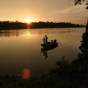 A father and son wrap up their fishing excursion as the sun sets over Copan Lake in northeast Oklahoma.