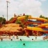 The Pelican Bay Aquatic Center in Edmond sends visitors plunging down two 150-foot water slides and floating along a lazy river.  The municipal aquatic center also features spray and play areas, a climbing wall, slide splash pool, diving boards and a vortex.