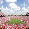 The football stadium at the University of Oklahoma is a sea of crimson and cream as the fans cheer on the Sooners.