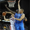 Serge Ibaka and Cole Aldrich of the OKC Thunder NBA basketball team block a shot by a Miami Heat player.