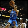 Russell Westbrook goes up for a shot during an OKC Thunder NBA game at the Chesapeake Energy Arena.
