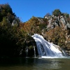 Magnificent scenery in any season, Turner Falls cascades 77 feet into a natural swimming pool. The cliffs surrounding the falls offer caves and trails to explore.