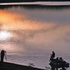 A fisherman casts his line at as the last colorful rays of sunlight reflect on the surface of Dripping Springs Lake at Okmulgee State Park.  Dripping Springs Lake was Oklahoma's first designated trophy bass lake and is a popular destination on the fishing tournament circuit.