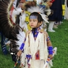 A young participant dances at the Kaw Nation Intertribal Powwow in northern Oklahoma's Kaw City.