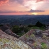 A magnificent sunset accentuates the rugged beauty of the Wichita Mountains Wildlife Refuge near Lawton.  This outdoor recreation area features outstanding hiking opportunities as well as rock climbing, wildlife viewing and camping.