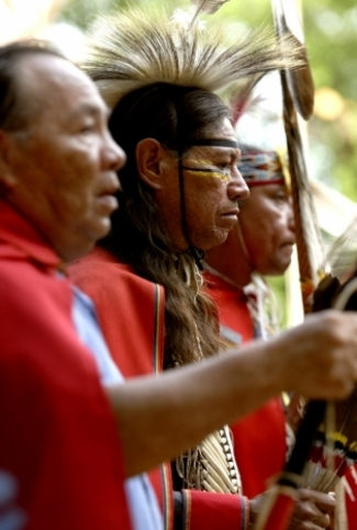 Members of the Kiowa Black Leggings Warrior Society take part in a ceremony to honor veterans.  The public is invited to attend the annual event in Anadarko which includes two days of traditional dancing and ceremonial festivities.