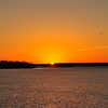 A glorious sunrise sets the sky on fire over Lake Thunderbird in Norman.  Lake Thunderbird State Park offers a wide variety of water recreation as well as hiking and biking trails, fishing, camping and a nature center.