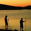 Boys wade in Lake Elmer Thomas as they enjoy a gorgeous sunset.  Set amidst the ancient and scenic Wichita Mountains, the Lake Elmer Thomas Recreation Area, known as LETRA, offers cabins, campsites, swim beaches and a variety of outdoor recreation activities.