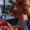 The free watermelon feast at Edmond's Libertyfest is highly popular with the whole family.