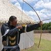 A Chickasaw re-enactor demonstrates archery techniques at the Chickasaw Cultural Center in Sulphur.