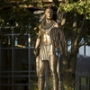 A bronze warrior stands on the grounds of the Chickasaw Cultural Center in Sulphur.